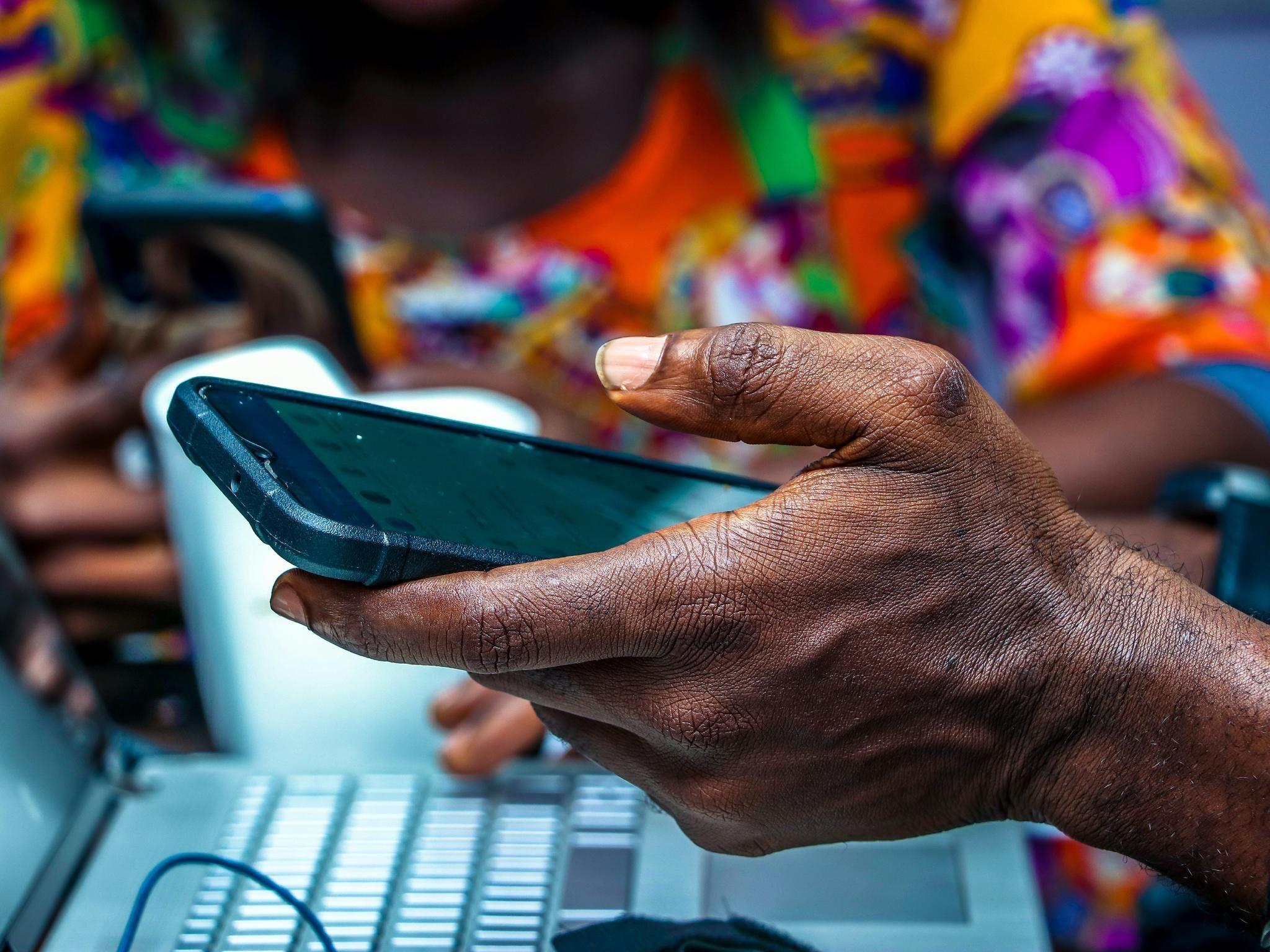 refugee camp digital technology iec phones
