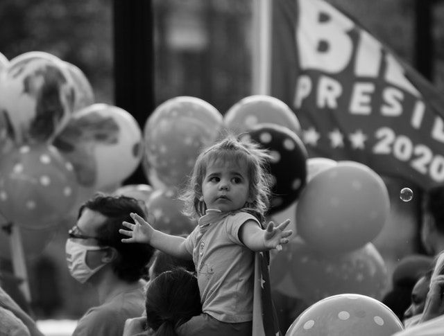 Young Girl at a public demonstration in support to Joe Bien. Photo by Drew Anderson from Pexels.
