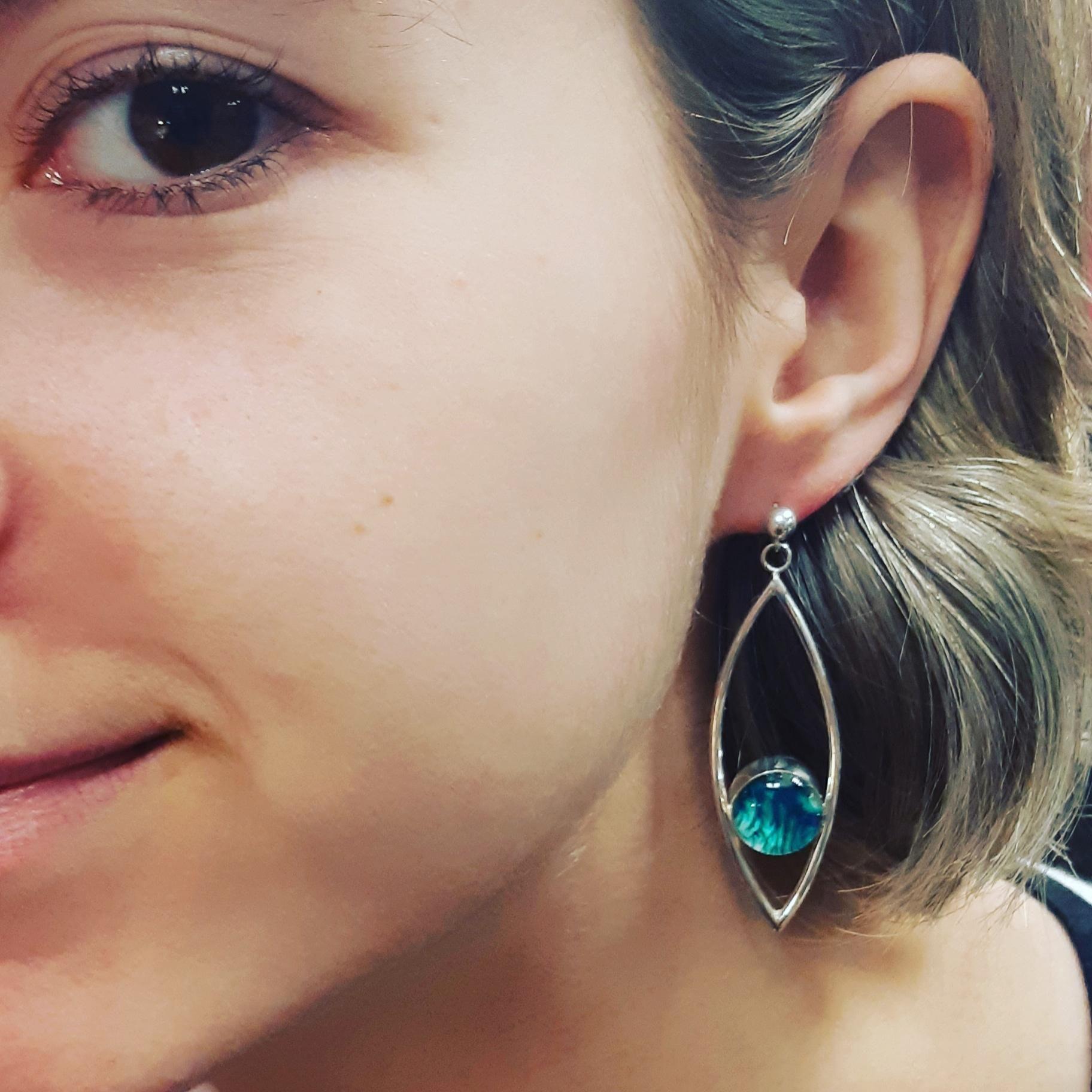 Fish eye drop sterling silver earrings