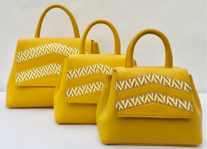 three yellow bags in a row