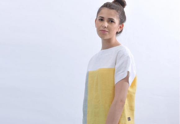 Women wearing a white, yellow and grey t-shirt