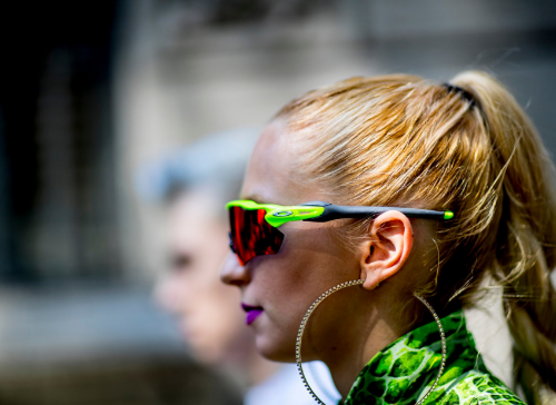 Woman with a ponytail and green sunglasses