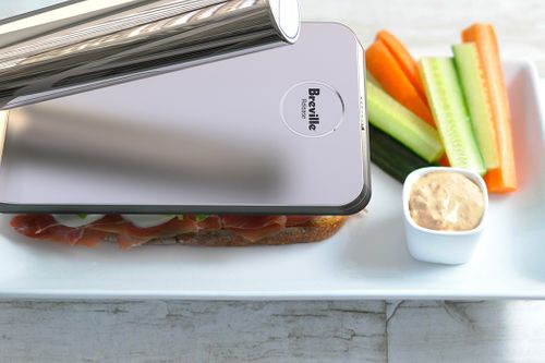 A SINGLE-PLATE FOOD PRESS FOR THE PERFECTLY SEARED SANDWICH IN HALF THE CUPBOARD SPACE!