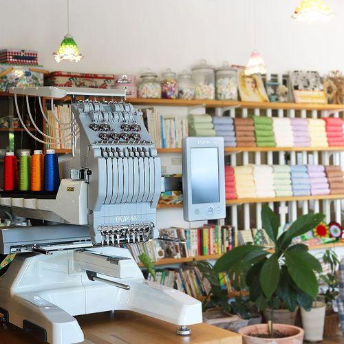 Tajima SAI. Compact Industrial Embroidery Machine