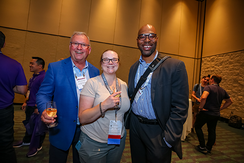group of three people at a networking reception