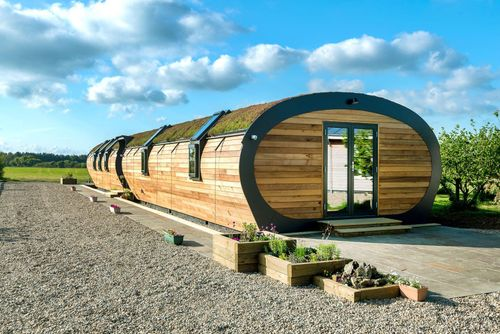 Modular provider exhibits curved green roof on unique eco-building