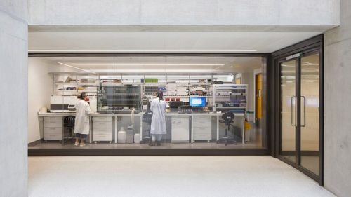 The Zayed Centre for Research into Rare Disease in Children features street-level glazing that allow people walking past to peer into its laboratories