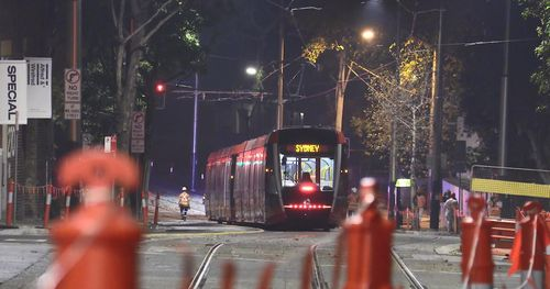A sight to behold as Sydney's first tram in 60 years passes through George Street.