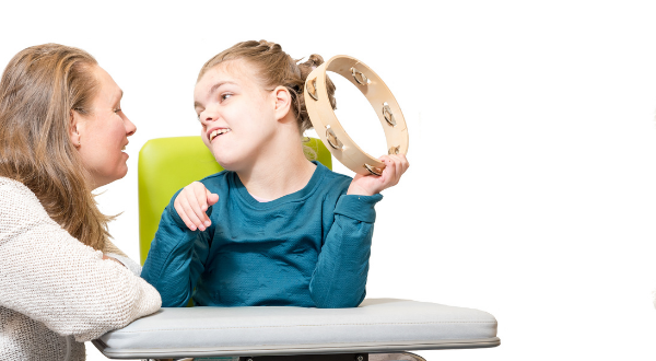 Child playing the tambourine.