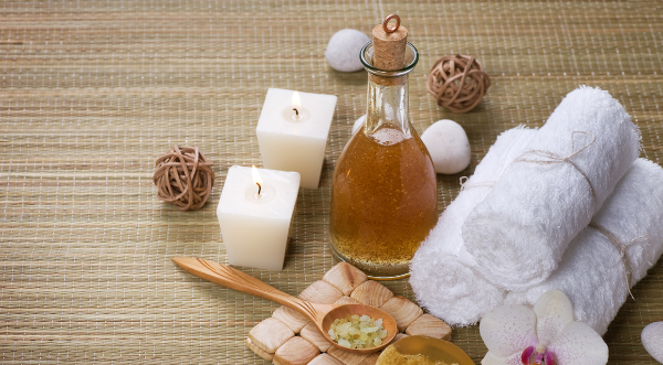 Picture of a pamper package, with things such as oils and candles.