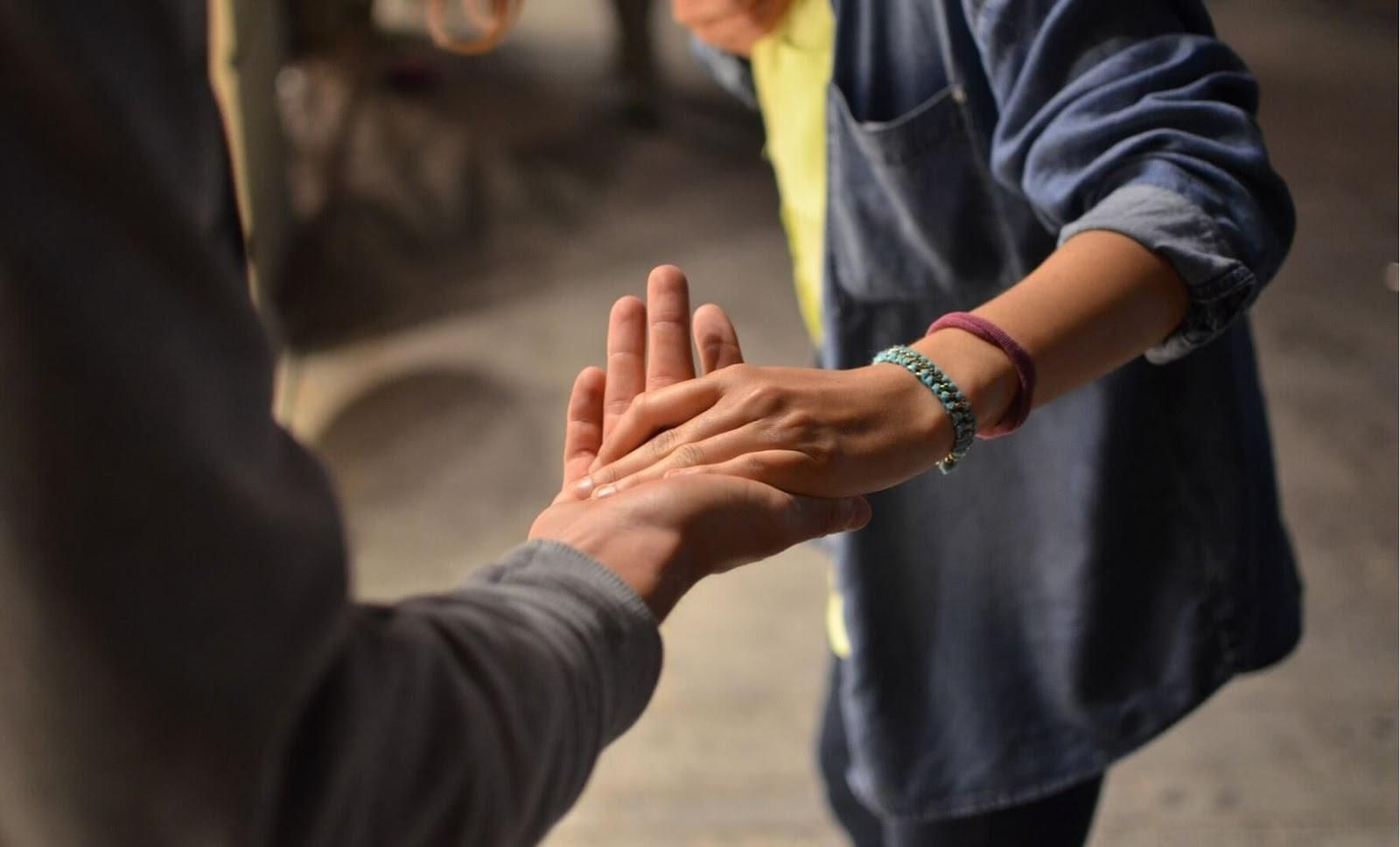 Picture of two people holding hands