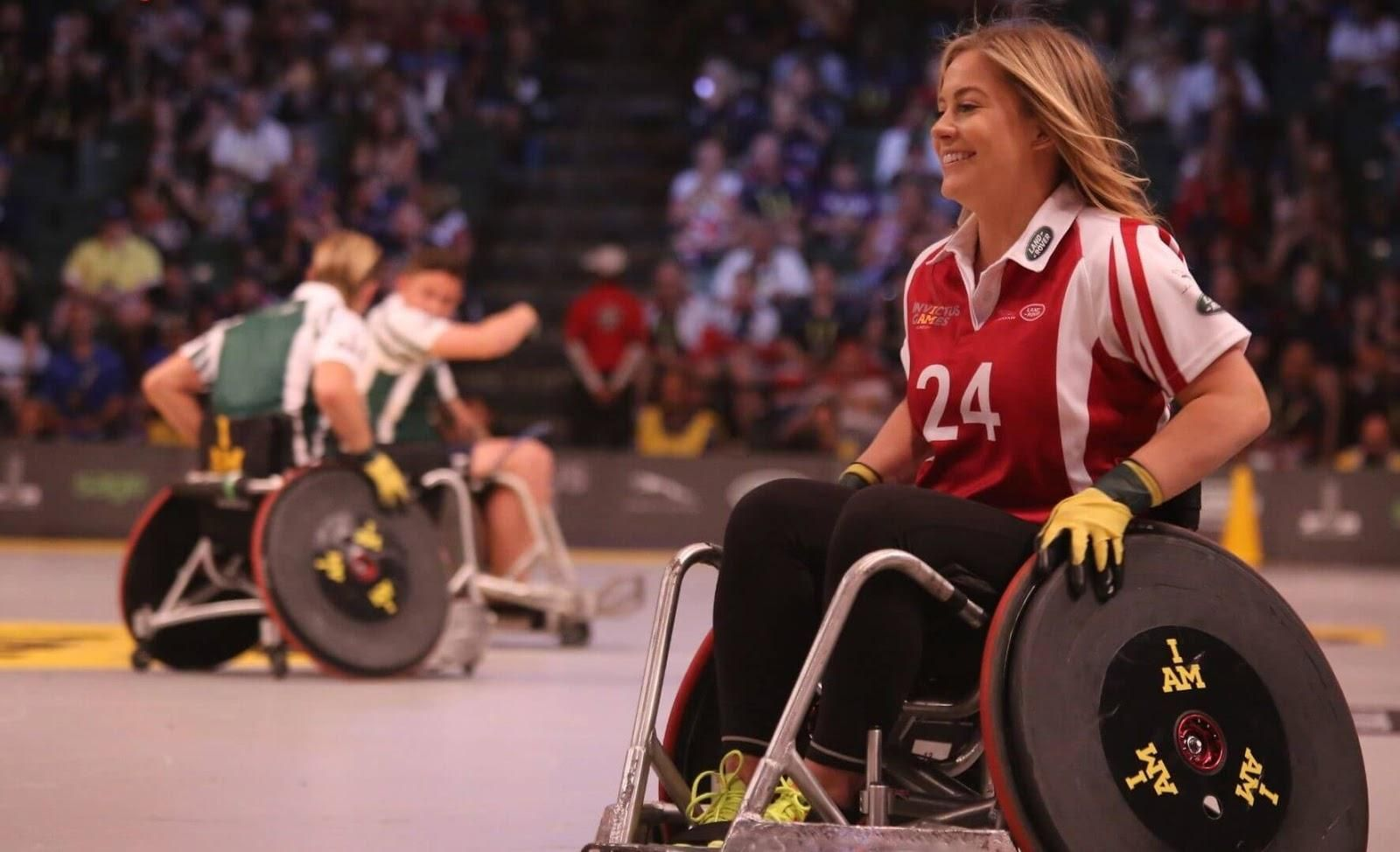 Picture of a young woman playing sports on a wheelchair.