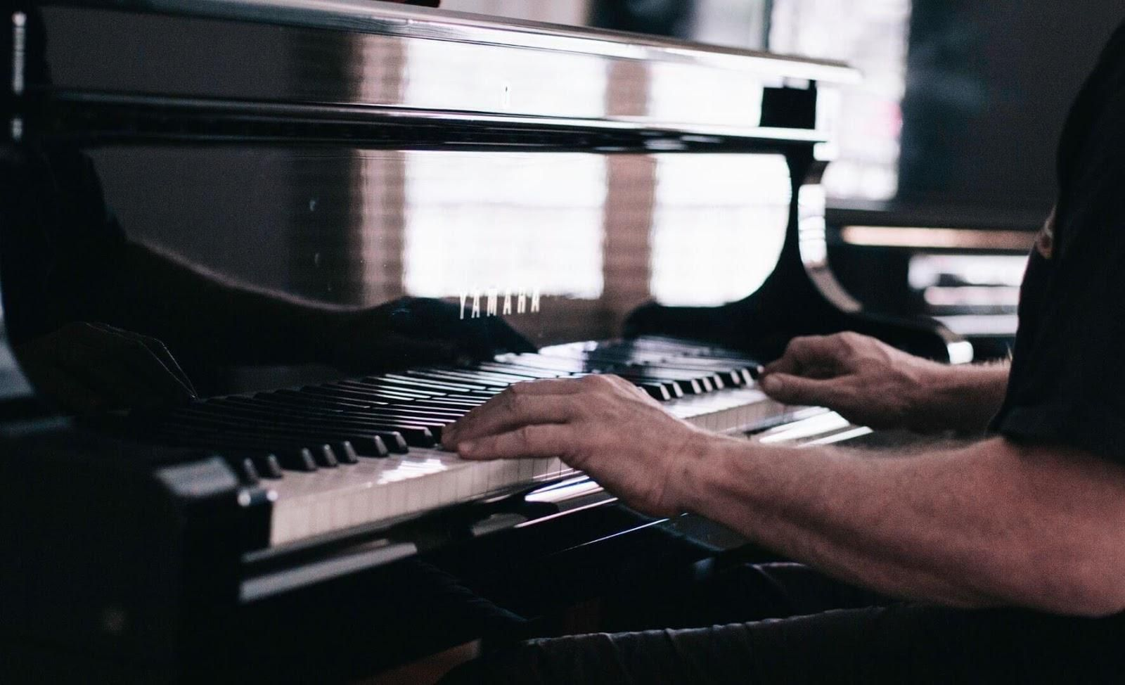 Picture of a person playing the piano.