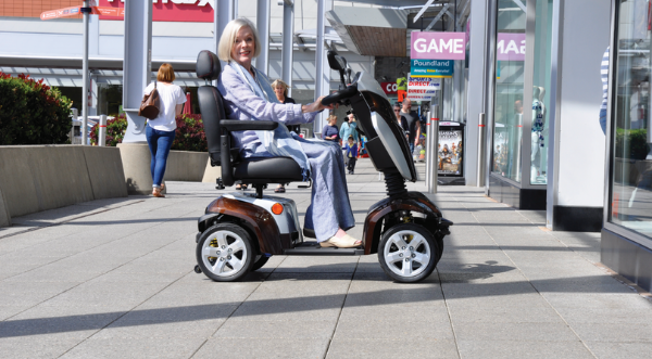 Picture of a woman using an electric scooter.