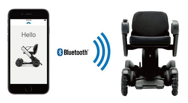 Image of a wheelchair with a phone next to it.