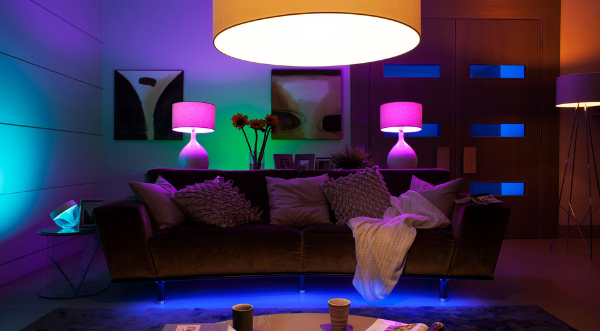 Picture of a living room with colourful smart lights on.
