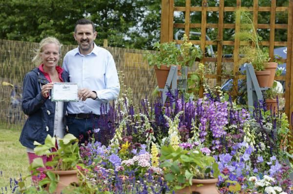 Natalie Forkin with her Award, and Gardeners' World presenter Adam Frost