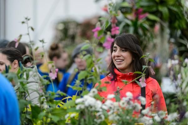 visitor shopping in the floral marquee