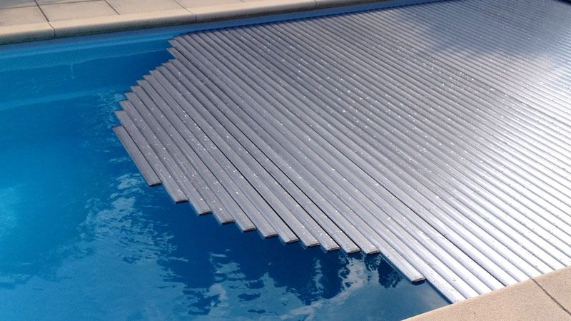 High quality, fully automatic slatted pool covers from Technics & Applications bvba